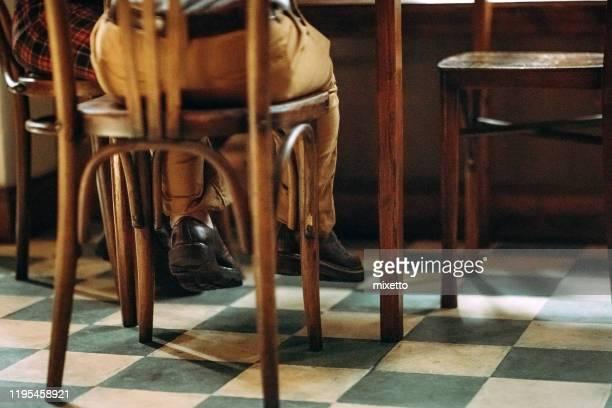 dwarfish man sitting at cafe - dwarf man stock pictures, royalty-free photos & images
