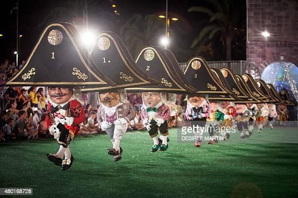 Dwarves dance during the 'Danza de los Enanos' of the 68th descent of the Virgin of the Snows in Santa Cruz de La Palma on the Spanish Canary Island...