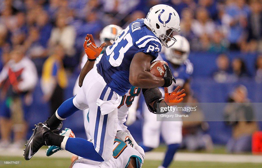 Dwayne Allen #83 of the Indianapolis Colts battles for extra yards after a fourth quarter catch while playing the Miami Dolphins at Lucas Oil Stadium on November 4, 2012 in Indianapolis, Indiana. Indianapolis won the game 23-20.