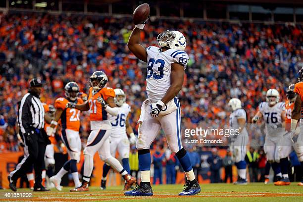 Dwayne Allen of the Indianapolis Colts celebrates a second quarter touchdown against the Denver Broncos during a 2015 AFC Divisional Playoff game at...
