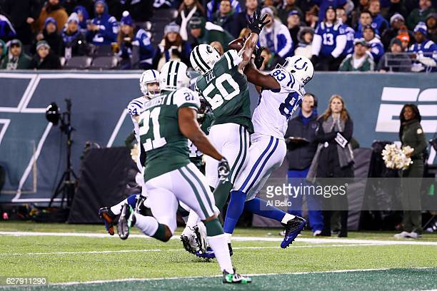 Dwayne Allen of the Indianapolis Colts completes a reception for a touchdown as Darron Lee of the New York Jets defends in the second quarter during...