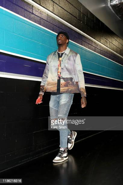 Dwayne Bacon of the Charlotte Hornets arrives to the arena before the game against the Orlando Magic on April 10 2019 at Spectrum Center in Charlotte...