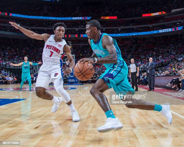 Dwayne Bacon of the Charlotte Hornets dribbles the ball past the defending Stanley Johnson of the Detroit Pistons during the Inaugural NBA game at...