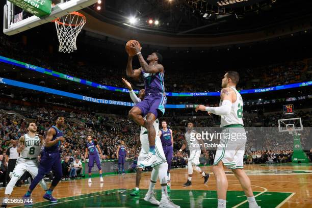 Dwayne Bacon of the Charlotte Hornets drives to the basket during the game against the Boston Celtics on February 28 2018 at the TD Garden in Boston...