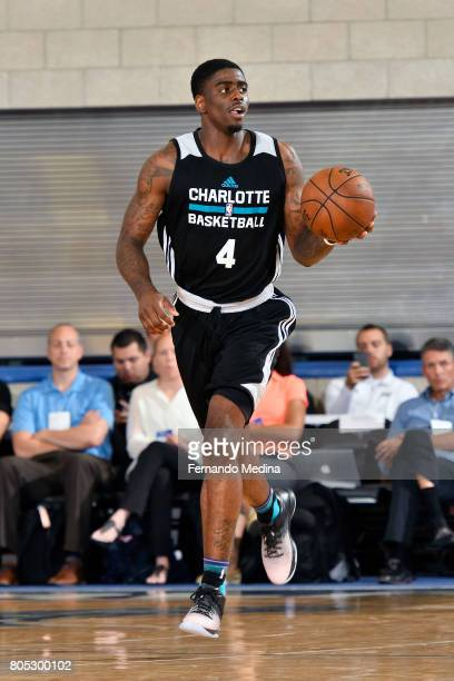 Dwayne Bacon of the Charlotte Hornets handles the ball against the Miami Heat during the 2017 Summer League on July 1 2017 at Amway Center in Orlando...