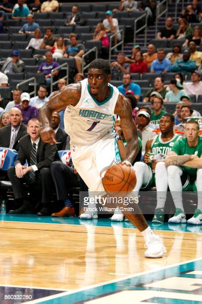 Dwayne Bacon of the Charlotte Hornets handles the ball against the Boston Celtics on October 11 2017 at Spectrum Center in Charlotte North Carolina...