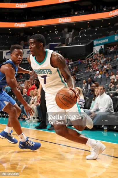 Dwayne Bacon of the Charlotte Hornets handles the ball against the Dallas Mavericks on October 13 2017 at Spectrum Center in Charlotte North Carolina...