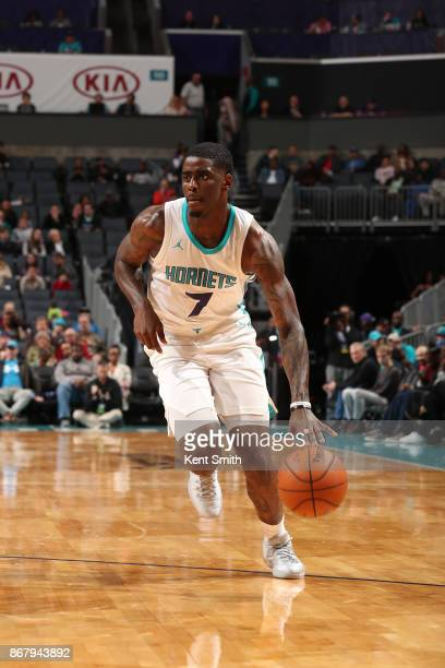 Dwayne Bacon of the Charlotte Hornets handles the ball against the Orlando Magic on October 29 2017 at Spectrum Center in Charlotte North Carolina...