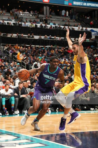 Dwayne Bacon of the Charlotte Hornets handles the ball against the Los Angeles Lakers on December 9 2017 at the Spectrum Center in Charlotte North...