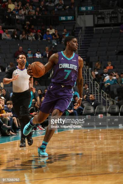 Dwayne Bacon of the Charlotte Hornets handles the ball against the Toronto Raptors on February 11 2018 at Spectrum Center in Charlotte North Carolina...