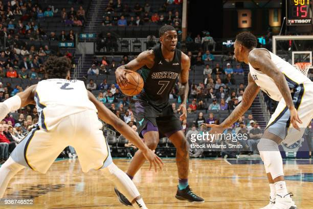 Dwayne Bacon of the Charlotte Hornets handles the ball against the Memphis Grizzlies on March 22 2018 at Spectrum Center in Charlotte North Carolina...