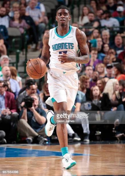 Dwayne Bacon of the Charlotte Hornets handles the ball against the Dallas Mavericks on March 24 2018 at the American Airlines Center in Dallas Texas...