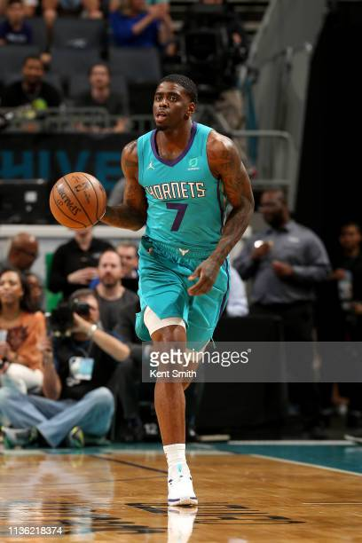 Dwayne Bacon of the Charlotte Hornets handles the ball during the game against the Orlando Magic on April 10 2019 at Spectrum Center in Charlotte...