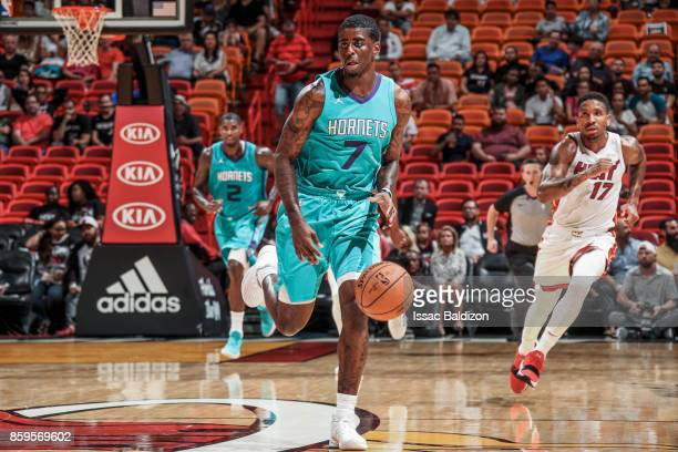 Dwayne Bacon of the Charlotte Hornets handles the ball during the preseason game against the Miami Heat on October 9 2017 at AmericanAirlines Arena...