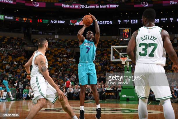 Dwayne Bacon of the Charlotte Hornets shoots the ball against the Boston Celtics during a preseason game on October 2 2017 at the TD Garden in Boston...