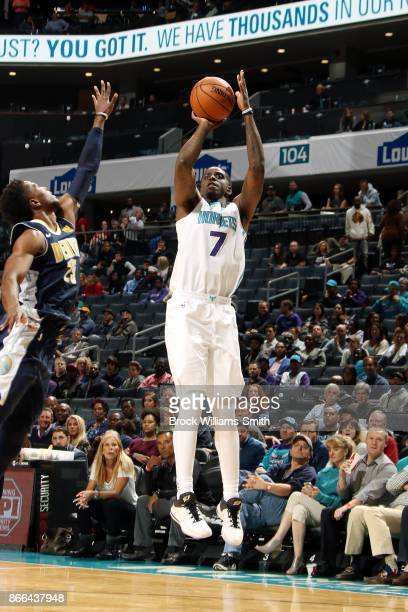 Dwayne Bacon of the Charlotte Hornets shoots the ball against the Denver Nuggets on October 25 2017 at Spectrum Center in Charlotte North Carolina...