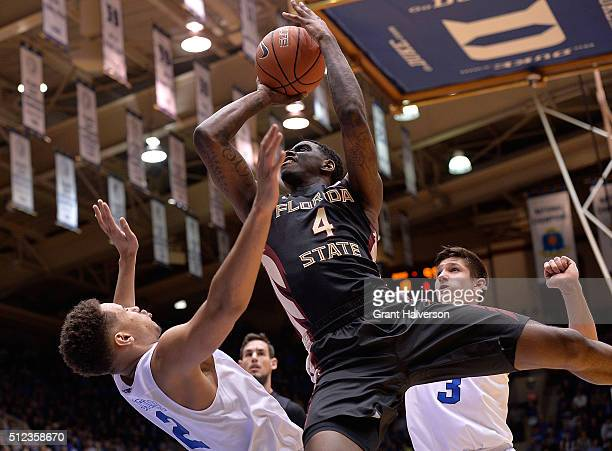 Dwayne Bacon of the Florida State Seminoles drives but was called for charging against Chase Jeter of the Duke Blue Devils during their game at...