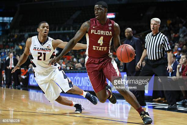 Dwayne Bacon of the Florida State Seminoles drives to the basket against the Illinois Fighting Illiniin the second half during the consolation game...