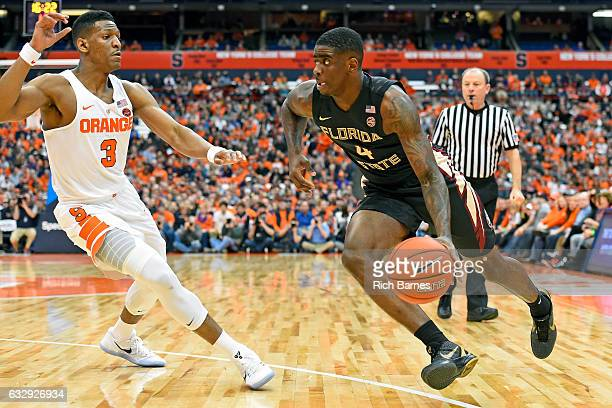 Dwayne Bacon of the Florida State Seminoles drives to the basket against the defense of Andrew White III of the Syracuse Orange during the first half...