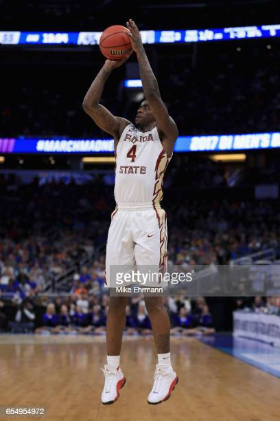 Dwayne Bacon of the Florida State Seminoles shoots a jump shot against the Xavier Musketeers in the second half during the second round of the 2017...
