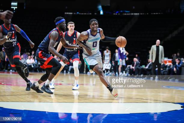 Dwayne Bacon of the Greensboro Swarm dribbles the ball against the Long Island Nets during an NBA G-League game on March 8, 2020 at Nassau Veterans...