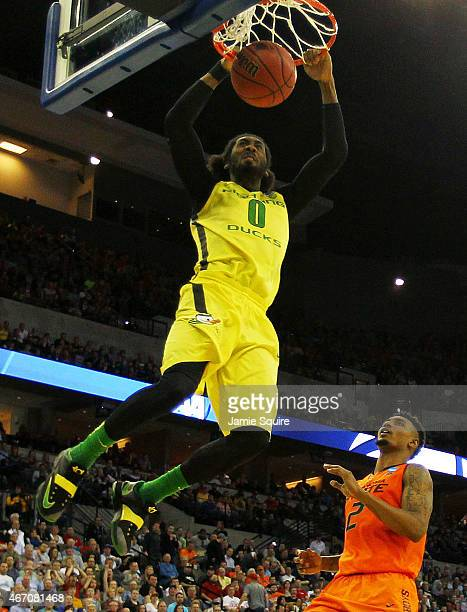 Dwayne Benjamin of the Oregon Ducks dunks over Le'Bryan Nash of the Oklahoma State Cowboys in the second half during the second round of the 2015...