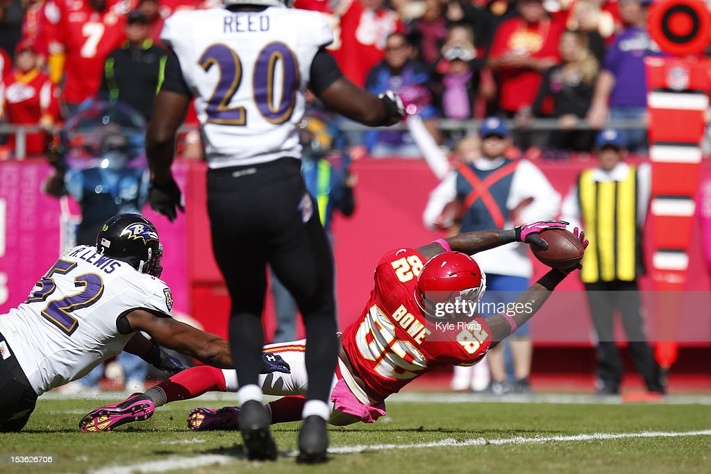Dwayne Bowe #82 of the Kansas City Chiefs falls in the end zone for a touchdown that would later be called back against the Baltimore Ravens late in the fourth quarter on October 07, 2012 at Arrowhead Stadium in Kansas City, Missouri.