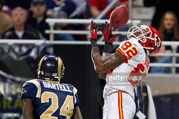 Dwayne Bowe of the Kansas City Chiefs hauls in a pass against Ronald Bartell of the St Louis Rams at the Edward Jones Dome on December 19 2010 in St...