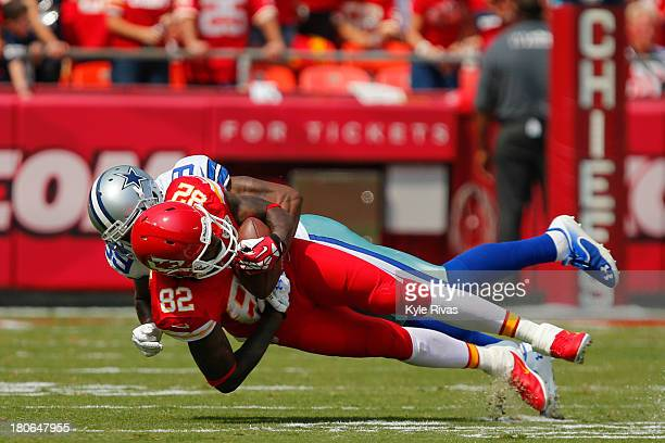 Dwayne Bowe of the Kansas City Chiefs is tackled by Brandon Carr of the Dallas Cowboys in the third quarter on September 15 2013 at Arrowhead Stadium...