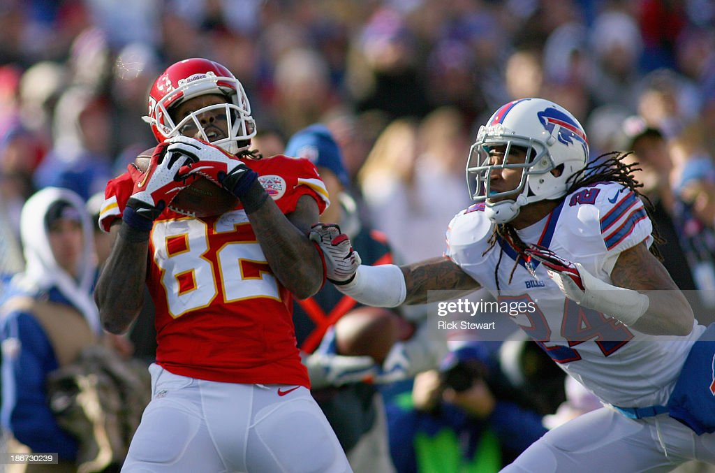 Dwayne Bowe #82 of the Kansas City Chiefs makes a catch against cornerback Stephon Gilmore #24 of the Buffalo Bills at Ralph Wilson Stadium on November 3, 2013 in Orchard Park, New York. Bowe was ruled out of bounds on the play.