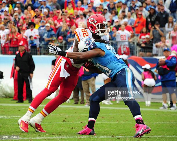 Dwayne Bowe of the Kansas City Chiefs runs with a catch against Michael Griffin of the Tennessee Titans at LP Field on October 6 2013 in Nashville...