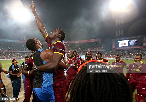 Dwayne Bravo and Carlos Brathwaite of the West Indies celebrate during the ICC World Twenty20 India 2016 final match between England and West Indies...