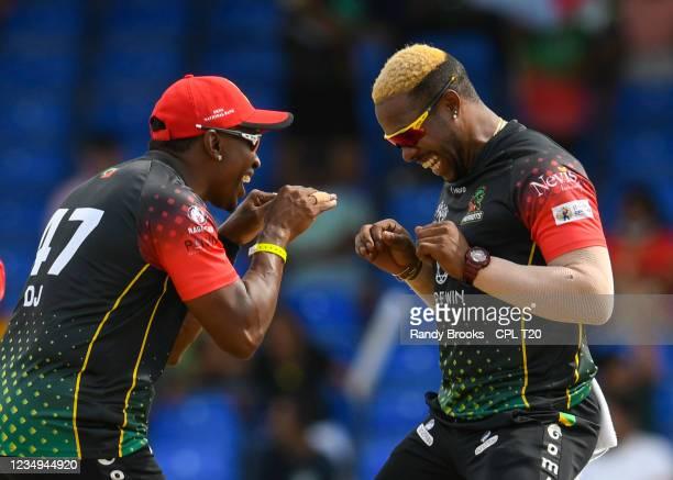 Dwayne Bravo and Fabian Allen of Saint Kitts & Nevis Patriots celebrates the dismissal of Chanderpaul Hemraj of Guyana Amazon Warriors during the...