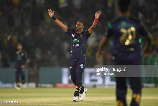 Dwayne Bravo of Quetta Gladiators celebrates after taking wicket of Daren Sammy of Peshawar Zalmi in the final Twenty20 Pakistan Super League at the...