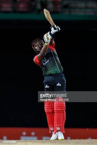 Dwayne Bravo of Saint Kitts & Nevis Patriots hits 6 during the 2021 Hero Caribbean Premier League Play-Off match 32 between Guyana Amazon Warriors...