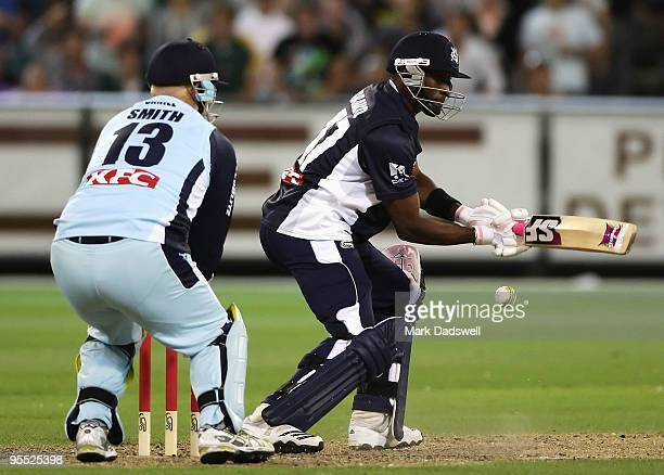 Dwayne Bravo of the Bushrangers square cuts during the Twenty20 Big Bash match between the Victorian Bushrangers and the New South Wales Blues at...