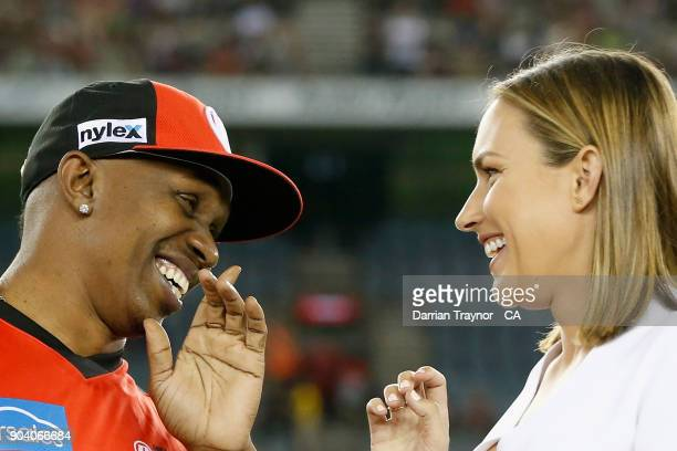 Dwayne Bravo of the Melbourne Renegades and TV presenter Roz Kelly share a laugh before the Big Bash League match between the Melbourne Renegades and...