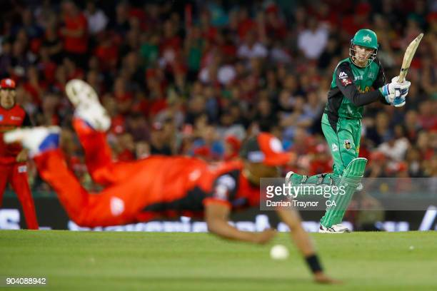 Dwayne Bravo of the Melbourne Renegades dives for a catch off Peter Handscomb of the Melbourne Stars during the Big Bash League match between the...