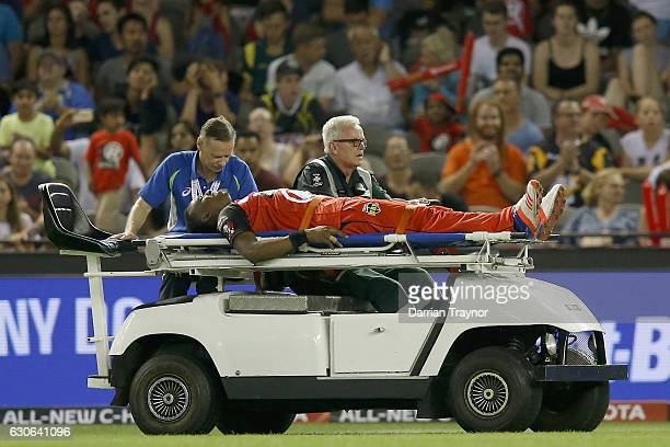 Dwayne Bravo of the Melbourne Renegades is taken from the ground on a stretcher after injuring himself in the field during the Big Bash League match...
