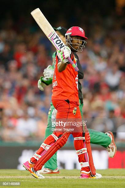 Dwayne Bravo of the Melbourne Renegades raises his bat after scoring 50 runs during the Big Bash League match between the Melbourne Renegades and the...