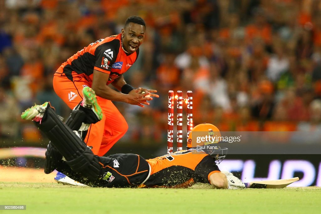 Dwayne Bravo of the Renegades celebrates running out Adam Voges of the Scorchers during the Big Bash League match between the Perth Scorchers and the Melbourne Renegades at WACA on January 8, 2018 in Perth, Australia.