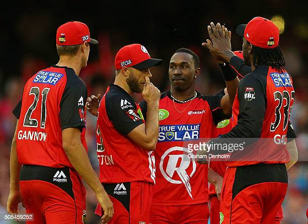 Dwayne Bravo of the Renegades celebrates with teammates after taking a catch to dismiss Jono Dean of the Strikers during the Big Bash League match...