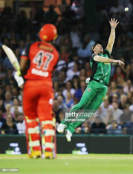 Dwayne Bravo of the Renegades hits the ball over John Hastings of the Stars during the Big Bash League match between the Melbourne Renegades and the...
