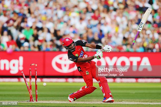 Dwayne Bravo of the Renegades is bowled as his bat flies off in the air during the Big Bash League match between the Melbourne Stars and the...