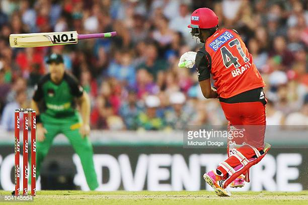 Dwayne Bravo of the Renegades loses grip of his bat while playing a shot during the Big Bash League match between the Melbourne Renegades and the...