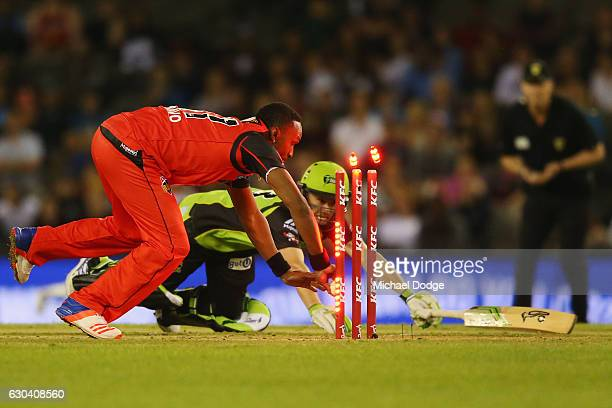 Dwayne Bravo of the Renegades runs out Jake Doran of the Thunder during the Big Bash League match between the Melbourne Renegades and Sydney Thunder...