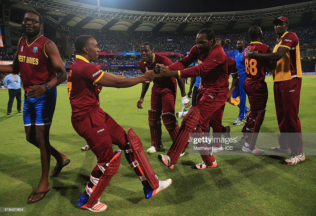 Dwayne Bravo of the West Indies and Chris Gayle of the West Indies celebrate their teams win over India during the ICC World Twenty20 India 2016 Semi-Final match between West Indies and India at the Wankhede Stadium on March 31, 2016 in Mumbai, India.