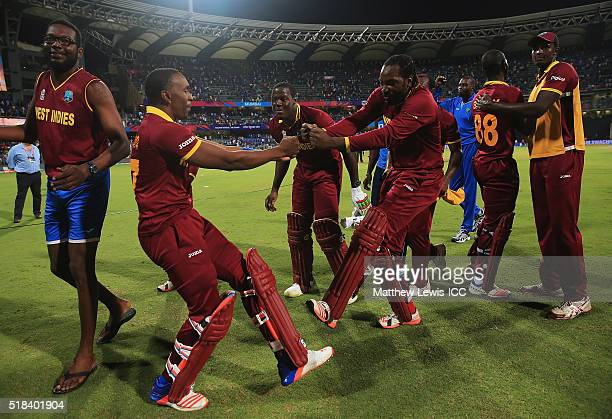 Dwayne Bravo of the West Indies and Chris Gayle of the West Indies celebrate their teams win over India during the ICC World Twenty20 India 2016...