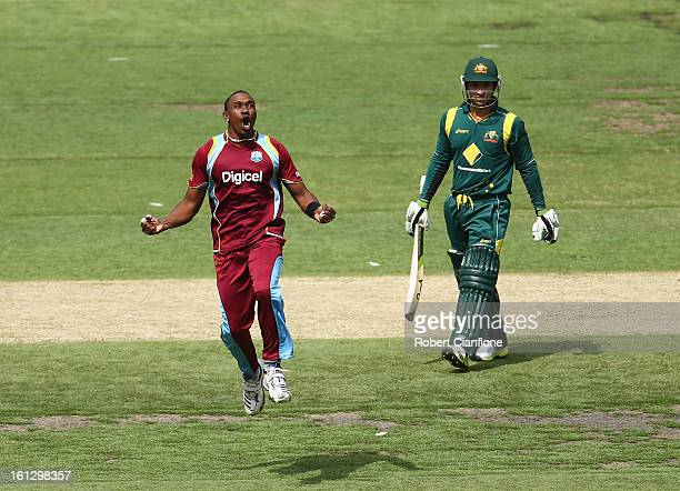 Dwayne Bravo of the West Indies celebrates after taking the wicket of Phillip Hughes of Australia during game five of the Commonwealth Bank...