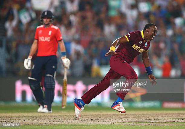 Dwayne Bravo of the West Indies celebrates after taking the wicket of Moeen Ali of England during the ICC World Twenty20 India 2016 Final match...